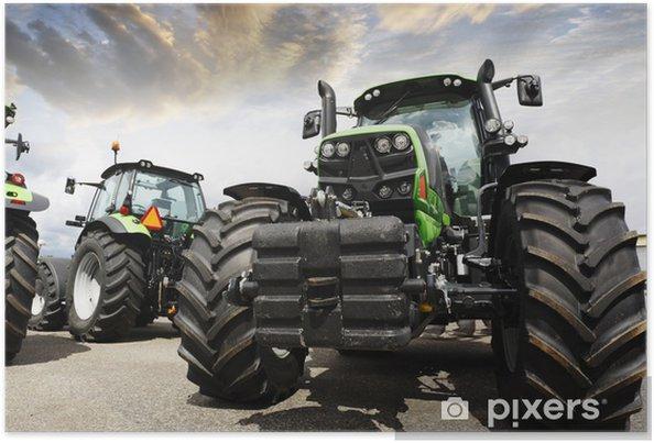 Plakat Olbrzymie traktory ustawione przed zachodem słońca niebo i chmury - Tematy