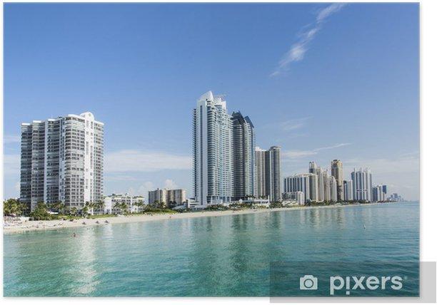 Plakat Piękna plaża z lokatorskie i wieżowiec w Sunny Island - Ameryka