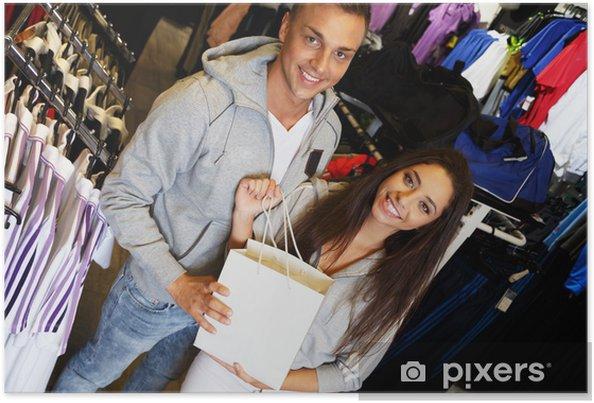 Plakat Szczęśliwa młoda para z torby na zakupy w sklepie odzieży sportowej - Moda