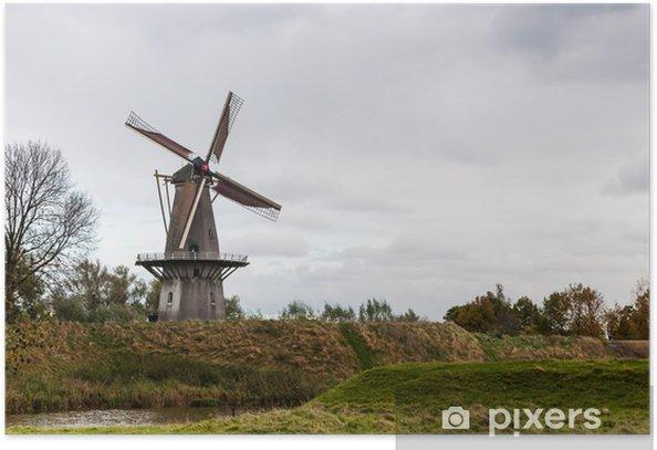Plakat Zabytkowy wiatrak na ścianie starej twierdzy holenderskiej - Pory roku
