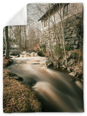 Spring flood running past old smeltery, long exposure