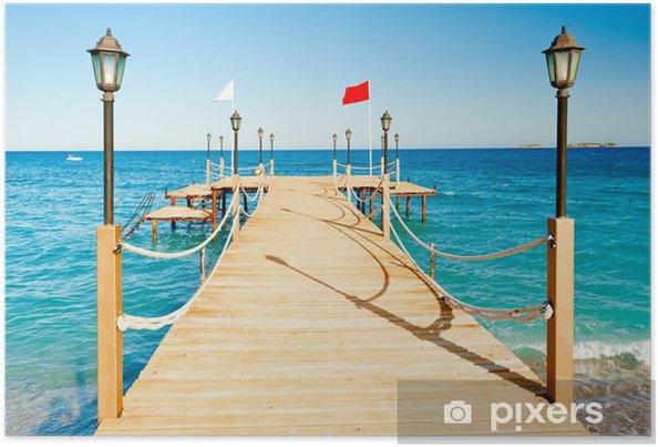 Strålande Poster Belysningsstolpar och rep staket på träbrygga • Pixers JW-71