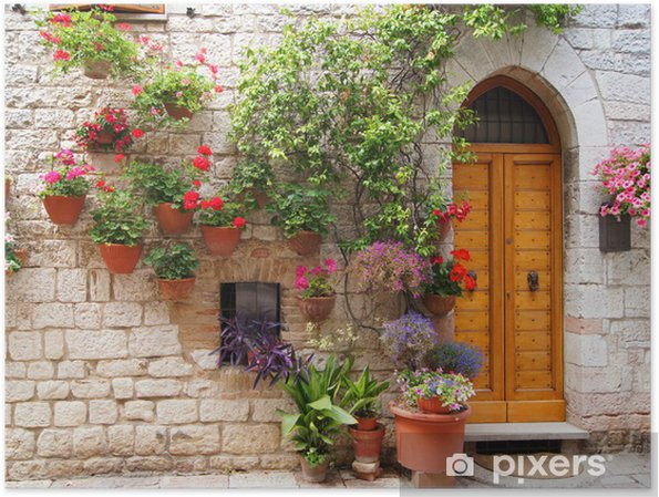 Colorful flowers outside a home in Assisi, Italy Poster