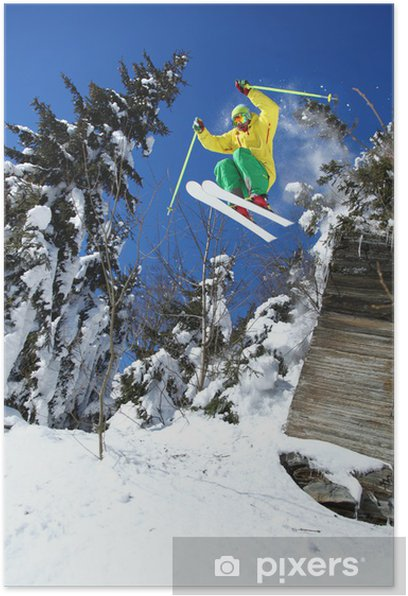 Cool skier jumping against blue sky from the rock Poster - Skiing