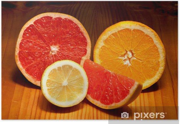 Poster Des morceaux de citron, pamplemousse rouge et orange - Fruits