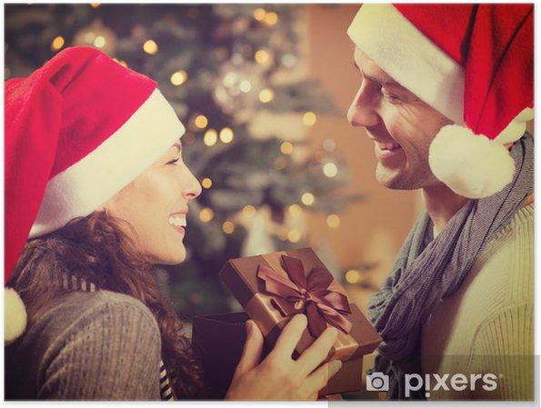 c9961e921798c Póster Feliz Navidad de los pares con el regalo de Navidad en el Hogar -  Celebraciones