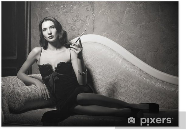 Film noir style: elegant young woman lying on sofa and smoking cigarette. Black and white Poster - People