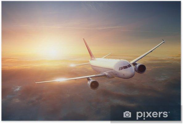 Poster Flygplan på himlen vid solnedgången -