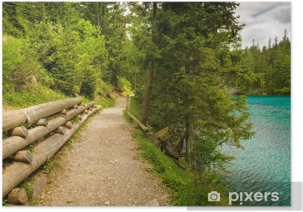 Gravel trail in mountains near turquoise lake. Poster - Europe