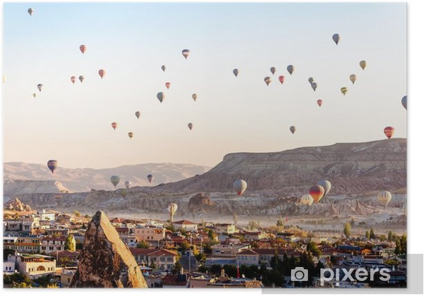 Hot air balloon flying over valleys in Cappadocia Turkey Poster - Travel