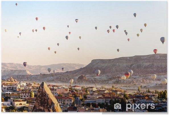 Hot air balloon flying over valleys in Cappadocia Turkey Poster - Travel