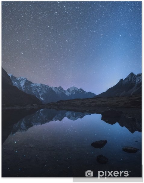Starry night in Nepal. Amazing night scene with mountains and lake. Landscape with high rocks with snowy peak and sky with stars reflected in water in Nepal. Travel in Himalayas. Space background Poster - Landscapes