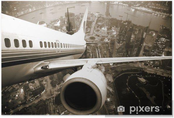 Poster Vertrekkend vliegtuig boven de stad -