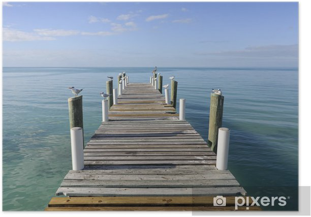 Wooden jetty leading into a turquoise sea in Governor's Harbour Poster