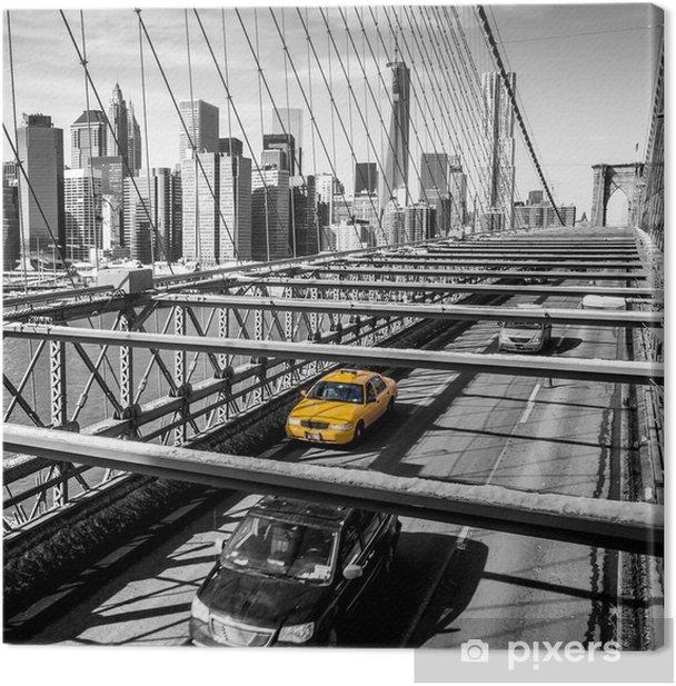 Quadro su Tela Taxi attraversando il ponte di Brooklyn a New York -