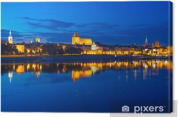 Quadro su Tela Torun città vecchia di notte riflessa nel fiume, Polonia - Temi