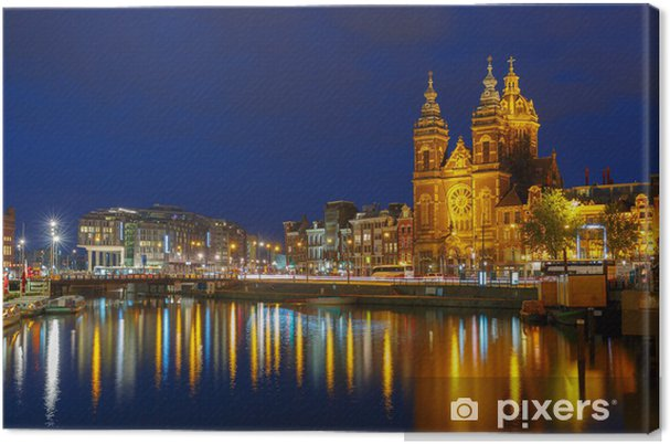 Quadro em Tela Night city view of Amsterdam canal and Basilica of Saint Nichola - Cidades europeias