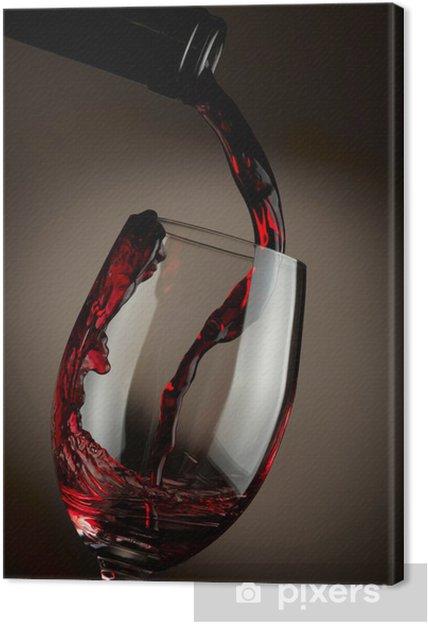 Quadro em Tela Red wine pouring in glass over dark background - Temas