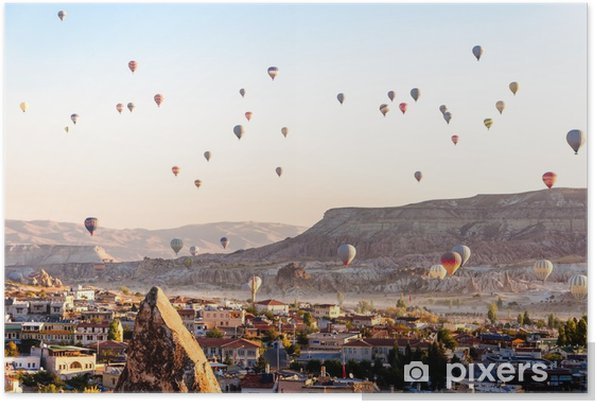 Hot air balloon flying over valleys in Cappadocia Turkey Self-Adhesive Poster - Travel