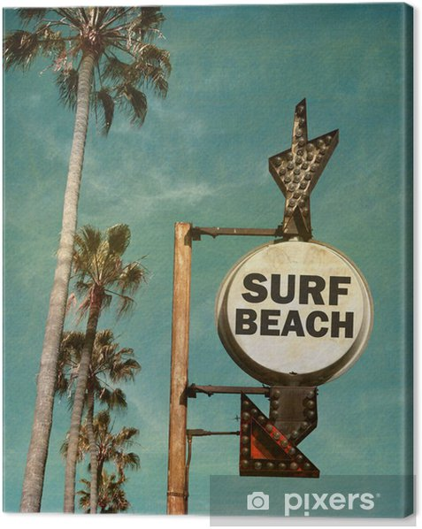 Tableau sur toile aged and worn vintage photo of surf beach sign with palm trees - Vacances