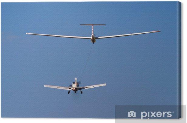 Tableau sur toile Avion de remorquage d'un planeur - Dans les airs