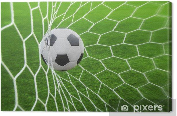 Tableau sur toile Ballon de football dans l'objectif -