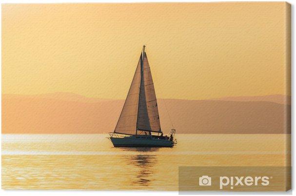 Tableau sur toile Bateaux à voiles avec un beau coucher de soleil - Sports aquatiques