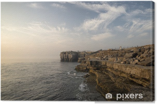 Tableau sur toile Beau paysage de falaise rocheuse avec coucher de soleil sur l'océan - Eau