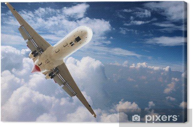 Tableau sur toile Big jet avion volant au-dessus des nuages - Dans les airs