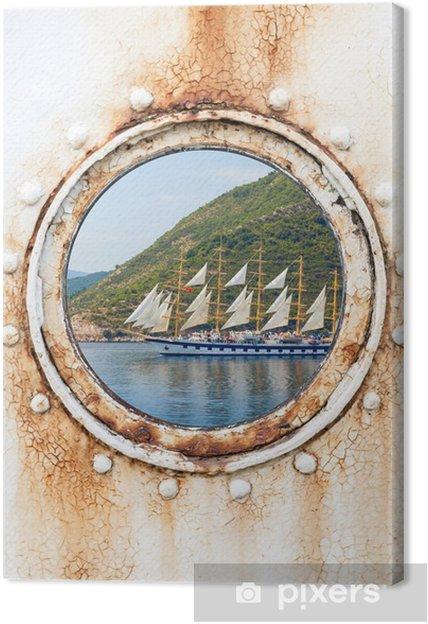 Tableau sur toile Big voilier derrière hublot rond rouillé sur un mur blanc - Bateaux