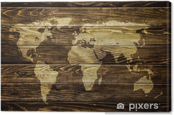 Tableau sur toile Carte du monde sur fond de bois -