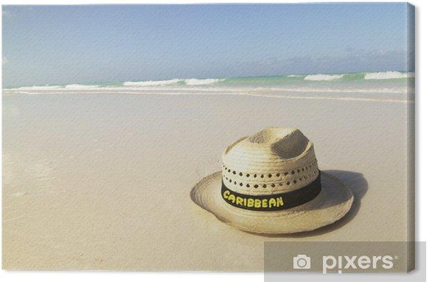 Tableau sur toile Chapeau sur la plage - Vacances