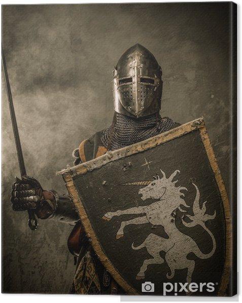 Tableau sur toile Chevalier médiéval avec l'épée et le bouclier contre mur de pierre - Chevaliers