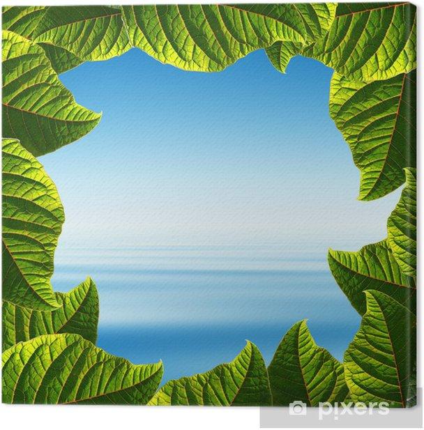 Tableau sur toile Ciel bleu et mer tropicale dans un cadre quelques feuilles fraîches » - Eau