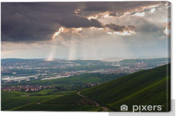 Tableau sur toile Ciel orageux nuageux avec casser rayons de soleil à travers - Catastrophes naturelles