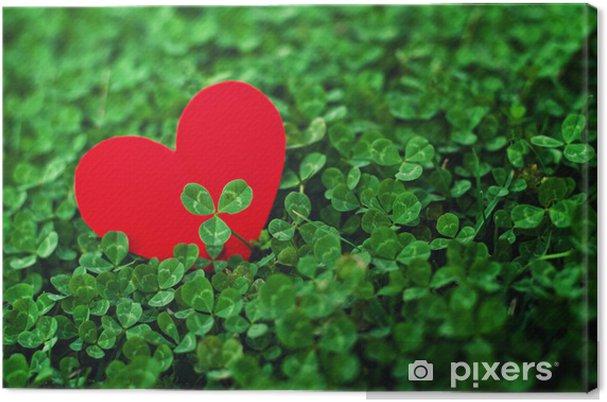 Tableau sur toile Coeurs de papier rouge dans le trèfle vert - Bonheur