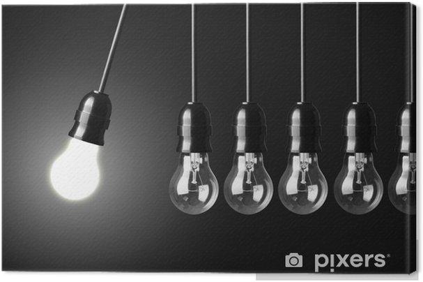 Tableau sur toile Concept d'idée sur le noir. mouvement perpétuel avec des ampoules - Business