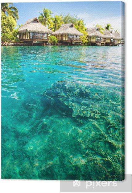 Tableau sur toile Des bungalows sur pilotis avec des étapes en vert lagon - Vacances