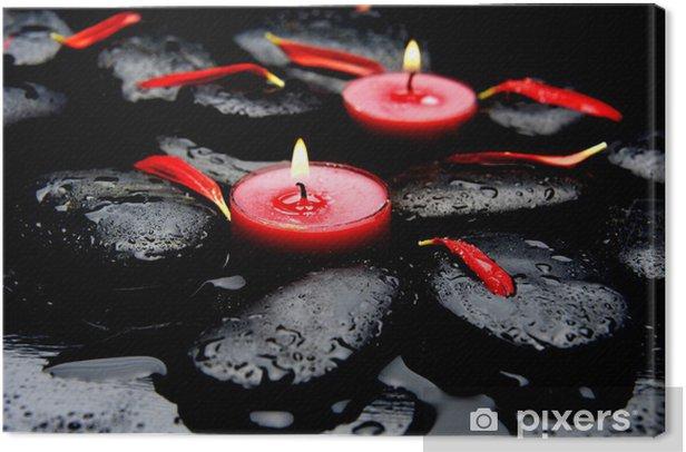 Tableau sur toile Deux pétales rouges de bougie rouge avec des pierres noires humides - Beauté et soins du corps