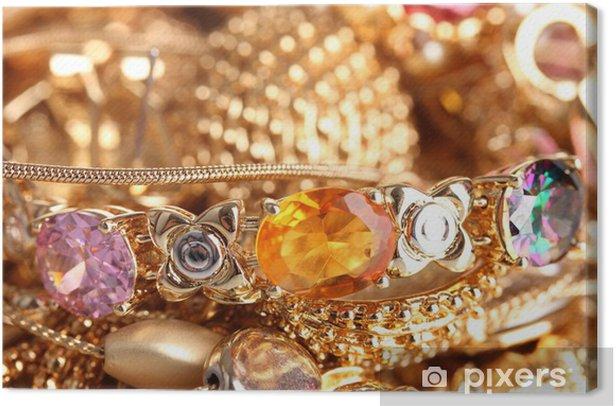 Tableau sur toile Divers bijoux en or gros plan -