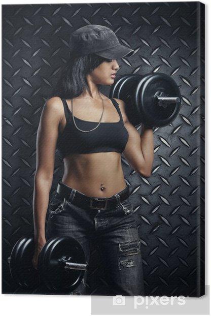 Tableau sur toile Femme avec des haltères -