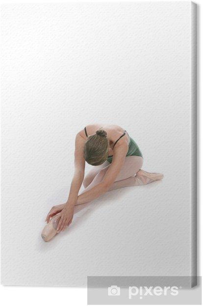 Tableau sur toile Femme en chaussons de ballet assis et d'étirement - Sports individuels