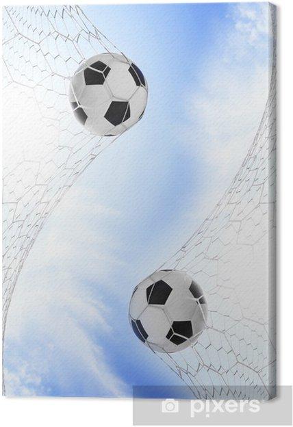 Tableau sur toile Football football en but dans un filet avec ciel bleu - Sports d'extérieur
