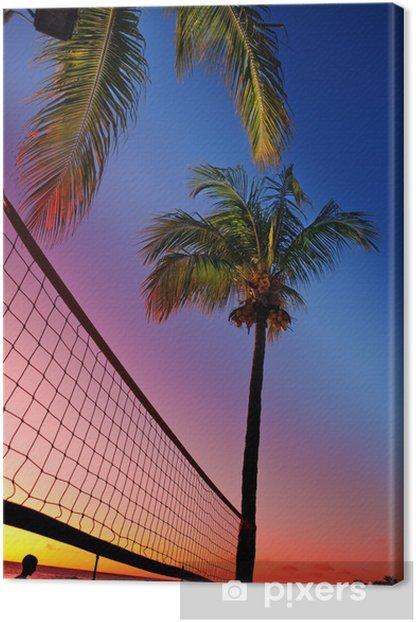Tableau sur toile Grille de beach-volley entre les palmiers au coucher du soleil - Volley-Ball