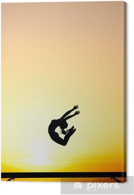 Tableau sur toile Gymnaste saute sur la poutre au coucher du soleil -