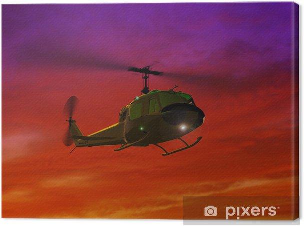 Tableau sur toile Hélicoptère UH-1 et le coucher du soleil rouge - Thèmes
