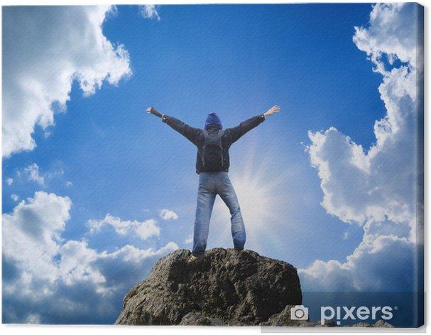 Tableau sur toile Homme sur le dessus de la montagne. - Réussite
