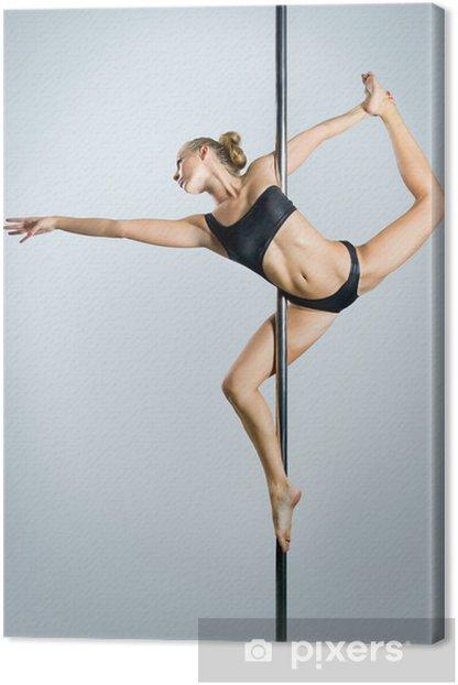 Tableau sur toile Jeune femme sexy pole dance exercice sur un fond gris - Sous-vêtements