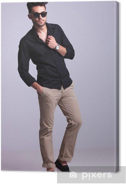 69fef350d6a Tableau sur toile Jeune homme de mode posant avec la main sur le maillot