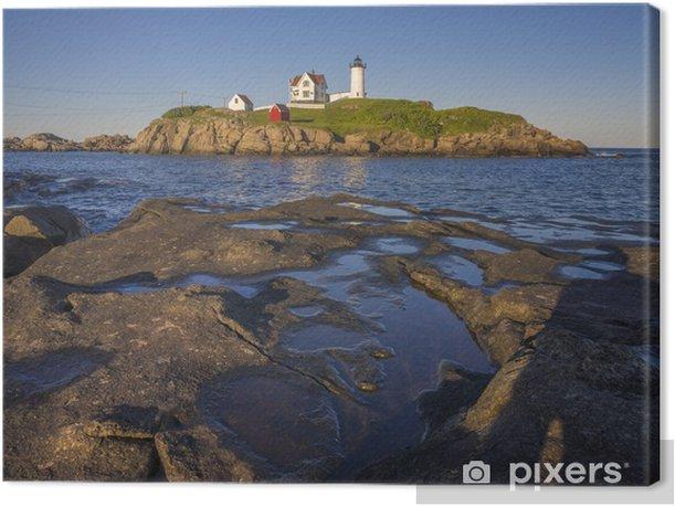 Tableau sur toile Le phare de protubérance au coucher du soleil à York, Maine - Amérique